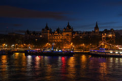 Whitehall Court at dusk. Whitehall Court in London at dusk, with the Thames in the foreground Royalty Free Stock Images