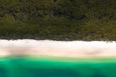 Whitehaven Beach on the Whitsunday Islands. Aerial flight over Whitehaven Beach on the Whitsunday Islands, Queensland, Australia - one of the world`s most Royalty Free Stock Image