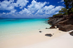 Whitehaven Beach in the Whitsundays. The amazing blue water of Whitehaven Beach in the Whitsundays is a very popular tourist location in Queensland, Australia Royalty Free Stock Photo