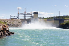 Whitehorse hydro power dam spillway Yukon Canada. Violent white water in spillway of hydro-electric power plant of the small scale hydro station at Whitehorse Stock Image