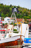 Whitel wooden boat with pirate flag Royalty Free Stock Images