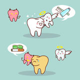 Whiten teeth vs brown teeth. Cartoon whiten teeth vs brown teeth with angel and devil , great for health dental care concept Stock Images