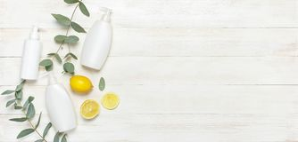 Free Whites Cosmetic Bottle Containers, Fresh Lemon Eucalyptus On White Wooden Background Top View Flat Lay Copy Space. Blank Label For Royalty Free Stock Photography - 133663507