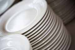 Whites plates for a reception Stock Photography