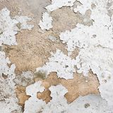 Whitewash falling off the wall Stock Photo