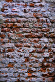 Whitewashed Brick Wall. Weathered brick wall texture with whitewashed areas Stock Image