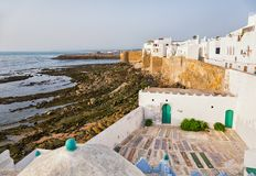 Whitewashed buildings in Asilah, Morocco. stock image