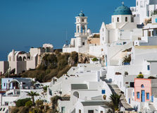 Whitewashed buildings on the hillside on Santorini island Royalty Free Stock Images