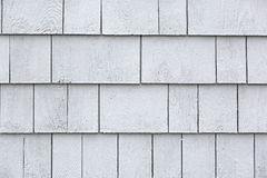 Whitewashed cedar shingles. Rows of damp whitewashed cedar shingles after a rainstorm Royalty Free Stock Image