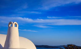 Whitewashed chimney in Santorini, Greece. Santorini island, Greece - White chimney and caldera view Royalty Free Stock Images