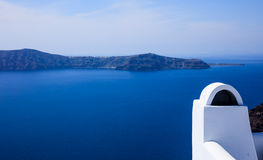 Whitewashed chimney in Santorini, Greece. Santorini island, Greece - White chimney and caldera view Stock Photos