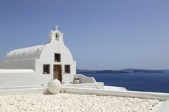 Whitewashed Church on Island of Santorini, Greece. Iconic, whitewashed architecture in the town of Oia, on the island of Santorini, Greece Royalty Free Stock Photos