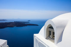 Whitewashed house detail in Santorini, Greece. Santorini island, Greece - White house detail and caldera view Royalty Free Stock Photography