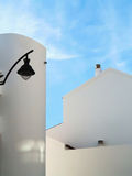 Whitewashed house with a street lamp Royalty Free Stock Images