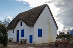 Whitewashed house with thatched roof stock photo