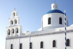 Whitewashed houses and blue dome church by the Aegean sea, Santoriniin Oia, Santorini, Greece. Famous blue domes in Oia village, stock photo