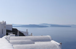 Whitewashed houses in Oia against caldera Royalty Free Stock Photos