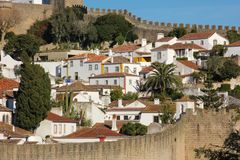 Whitewashed houses within the walled citadel. Obidos. Portugal Royalty Free Stock Image