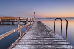 Whitewashed jetty at dusk Royalty Free Stock Photo