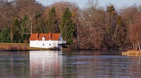 Whitewashed Lakeside Boathouse in Winter sunshine Royalty Free Stock Image