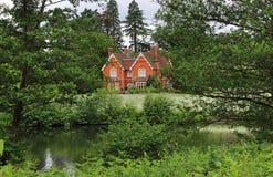 Whitewashed Lakeside House Stock Photo