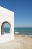 Whitewashed ocean front house Royalty Free Stock Images