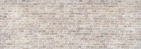 Whitewashed old brick wall panorama. Wide Beige brick wall panoramic background texture. Home and office design backdrop Royalty Free Stock Photo