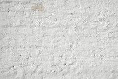 Whitewashed Retro Brick Wall Uneven Bumpy Rough Rustic Background. Texture Closeup stock photos