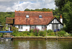 Whitewashed Riverside House Royalty Free Stock Photography