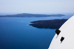 Whitewashed roof in Santorini, Greece. Santorini island, Greece - White roof and caldera view Royalty Free Stock Image