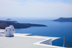Whitewashed roofs in Santorini, Greece. Santorini island, Greece - White roofs and caldera view Stock Photography
