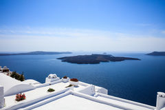 Whitewashed roofs in Santorini, Greece. Santorini island, Greece - White roofs and caldera view Royalty Free Stock Photos