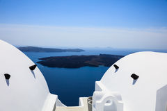 Whitewashed roofs in Santorini, Greece. Santorini island, Greece - White roofs and caldera view Stock Photo