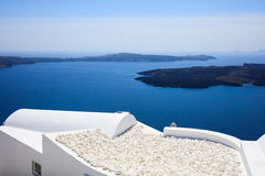 Whitewashed roofs in Santorini, Greece. Santorini island, Greece - White roofs and caldera view Royalty Free Stock Images