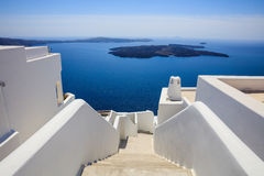Whitewashed roofs and stairs in Santorini, Greece. Santorini island, Greece - White houses and caldera view Stock Photography