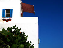 Whitewashed Seaside Building. Whitewashed seaside house typical of Mediterranean countries Royalty Free Stock Images