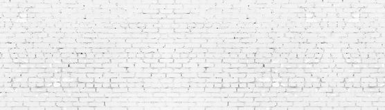 Whitewashed shabby brick wall wide panoramic texture. White painted aged brickwork panorama. Long light background. Whitewashed shabby brick wall wide panoramic royalty free illustration