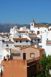 Whitewashed village, Sayalonga, Andalusia, Spain. View of the town and church with mountains to the rear, Sayalonga, Axarquia region, Malaga Province, Andalusia Stock Photos