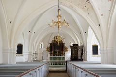 Whitewashed wedding church in Scania, Sweden. Way to altar in a swedish church Stock Image