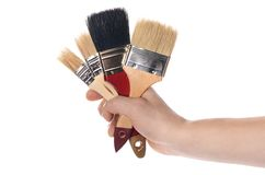 Whitewashing brush in a man's hand Royalty Free Stock Images