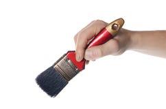 Whitewashing brush in a man's hand Stock Photo