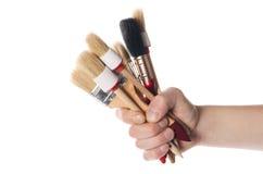 Whitewashing brush in a man's hand Royalty Free Stock Photos