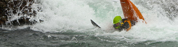 In whitewater. Panorama kayaker after jumping from the waterfall Stock Image
