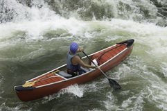 Whitewater Canoeist. Whitewater Canoe in rapids Royalty Free Stock Image