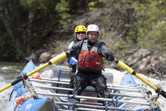 Whitewater couple. A couple enjoy whitewater rafting on a river in Idaho Stock Photography