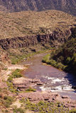Whitewater in the desert gorge Royalty Free Stock Photo
