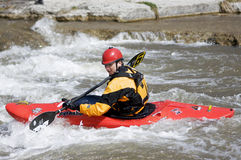 Whitewater Kayak - Port Hope, March 31, 2012. A participant paddles his playboat through the Ganaraska River rapids on March 31, 2012 in Port Hope, Ontario. The stock images