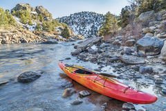 Whitewater kayak on river shore Royalty Free Stock Photography