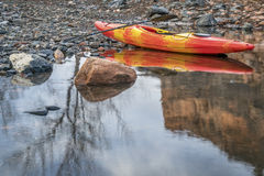 Whitewater kayak on rocky shore royalty free stock image