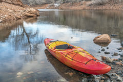 Whitewater kayak on rocky shore royalty free stock images